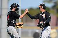 Mercer Bears pitcher Dimitri Kourtis #27 and catcher David Reid-Foley #18 celebrate after a game against the Notre Dame Fighting Irish at Buck O'Neil Complex on February 17, 2013 in Sarasota, Florida.  Mercer defeated Notre Dame 5-4.  (Mike Janes/Four Seam Images)