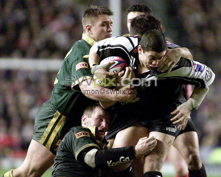 Picture by Shaun Flannery\SWpix.com - 25/11/00 - Rugby League World Cup Final 2000 - Australia v New Zealand, Old Trafford, Manchester, England - New Zealand's Nathan Cayless is halted by Australia.