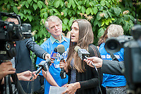 Edita Birnkrant, center, Director of NY Friends of Animals speaks to reporters at a news conference at City Hall in New York on Thursday, July 24, 2014.  The animal rights groups have been lobbying for the end of carriage horses for years claiming that they are inhumane and are frustrated that Mayor Bill De Blasio has not dismantled the industry yet, a claim he made during the election.  (© Ricard B. Levine)