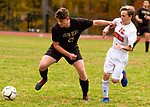 THOMASTON,  CT-101619JS03-  Thomaston's John Reeser (25) holds off Terryville's Noah Fernet (19) while getting control of the ball during their Berkshire League match up Wednesday at Nystrom Park in Thomaston.<br /> Jim Shannon Republican-American