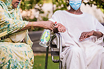 Sudanese woman sprays disinfectant at the hands of her husband, as a precaution against the spread of the coronavirus disease (COVID-19) in Khartoum, Sudan on May 05, 2020. Photo by faiz Abu bakr