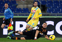 Calcio, semifinale di andata di Coppa Italia: Roma vs Napoli. Roma, stadio Olimpico, 5 febbraio 2014.<br /> AS Roma defender Leandro Castan, of Brazil, falls on the pitch during the Italian Cup first leg semifinal football match between AS Roma and Napoli at Rome's Olympic stadium, 5 FeBruary 2014.<br /> UPDATE IMAGES PRESS/Riccardo De Luca