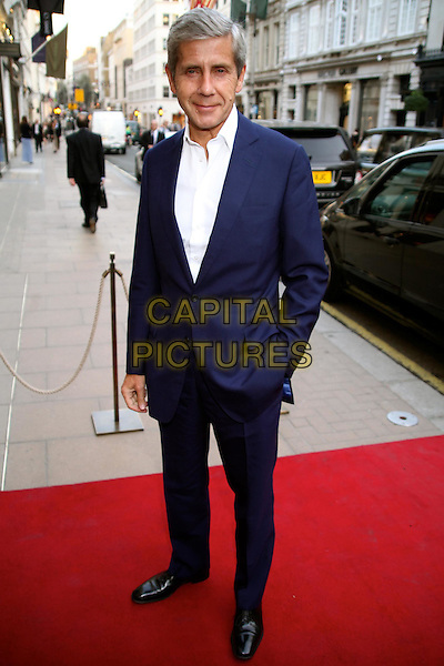 Sir Stuart Rose.Alexandra Shulman's 'Can We Still Be Friends?' debut novel launch party, Sotheby's, New Bond St., London, England..March 28th, 2012.full length white shirt blue suit hand in pocket.CAP/JEZ  .©Jez/Capital Pictures.