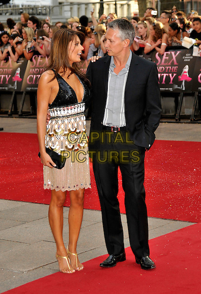 """DANIELLE BUX & GARY LINEKER .Red Carpet Arrivals at the """"Sex And The City"""" Movie World Premiere, Odeon Leicester Square, London, England, UK,.May 12th 2008...full length couple black sequined dress white gold patterned cleavage grey gray shirt suit shoes sandals .CAP/PL.©Phil Loftus/Capital Pictures"""