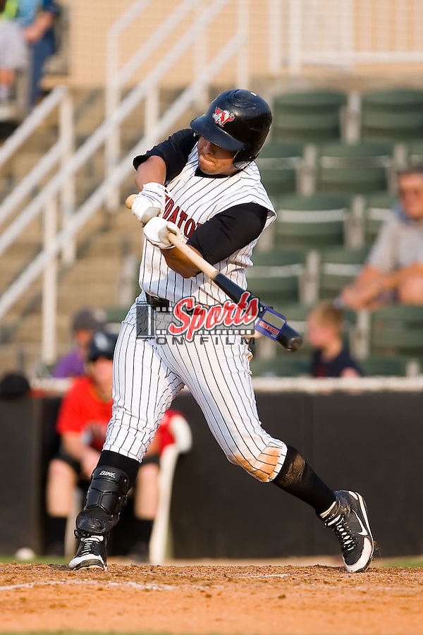 Second baseman Sergio Miranda (8) of the Kannapolis Intimidators makes contact with th ball for an RBI double at Fieldcrest Cannon Stadium in Kannapolis, NC, Sunday July 20, 2008. (Photo by Brian Westerholt / Four Seam Images)