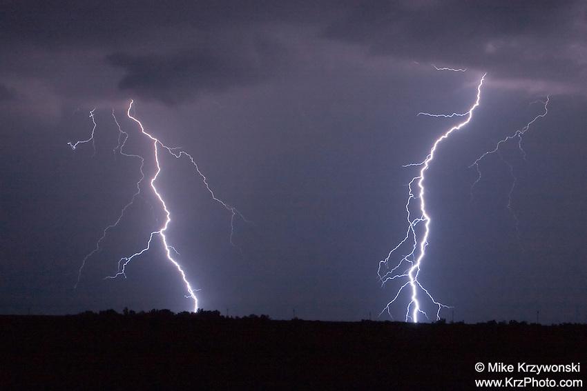 Twin lightning bolts at night in Kansas