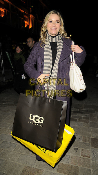 TAMZIN OUTHWAITE.The UGG Australia: London Store Launch in Covent Garden, London, England. .November 26th, 2008 .full length tamsin long purple coat jacket scarf striped stripes white grey gray cream bags shopping knitted purse.CAP/CAN.©Can Nguyen/Capital Pictures.