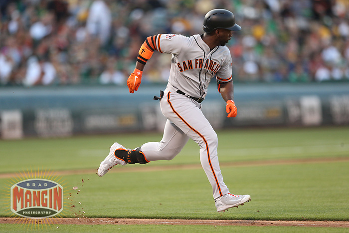 OAKLAND, CA - JULY 21:  Andrew McCutchen #22 of the San Francisco Giants runs to first base against the Oakland Athletics during the game at the Oakland Coliseum on Saturday, July 21, 2018 in Oakland, California. (Photo by Brad Mangin)