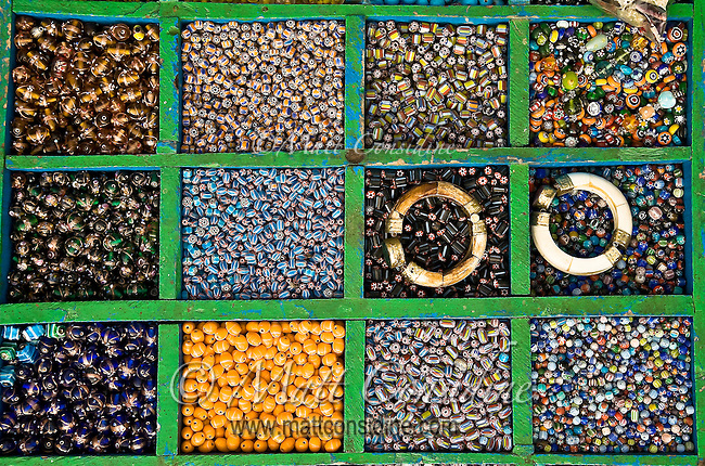 Colorful glass beads arranged in boxes and displayed for sale on the ghats in Varanasi.<br /> (Photo by Matt Considine - Images of Asia Collection)
