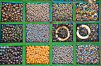 Colorful glass beads arranged in boxes and displayed for sale on the ghats in Varanasi. (Photo by Matt Considine - Images of Asia Collection)