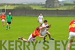 Gearoid Ó Suilleabháin for Dromid attacking is brought down by Valentia's Colm Casey.