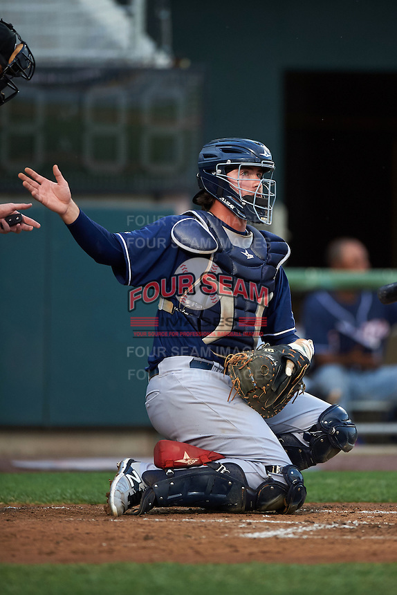 New Hampshire Fisher Cats catcher Jack Murphy (9) reaches for a new ball during a game against the Harrisburg Senators on July 21, 2015 at Metro Bank Park in Harrisburg, Pennsylvania.  New Hampshire defeated Harrisburg 7-1.  (Mike Janes/Four Seam Images)