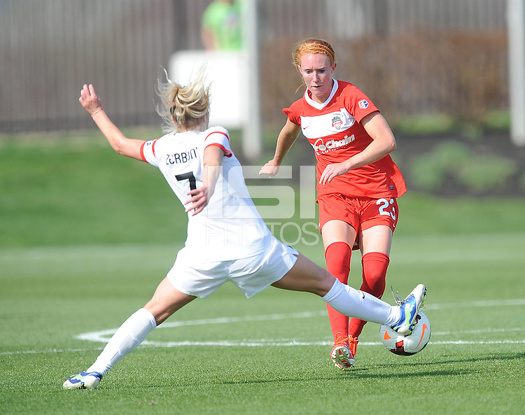 Boyds MD - April 13, 2014: Tori Huster (23) of the Washington Spirit goes against McCall Zerboni (7) of the Western New York Flash. The Western New York Flash defeated the Washington Spirit 3-1 in the opening game of the 2014 season of the National Women's Soccer League at the Maryland SoccerPlex.