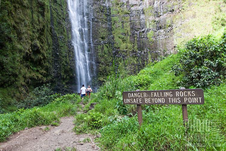 Warning sign posted near Waimoku Falls waterfall, Pipiwai hiking trail, Haleakala National Park, Kipahulu, Maui