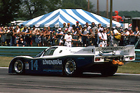ELKHART LAKE, WI - AUGUST 24: The Holbert Racing Porsche 962 103 of Al Holbert of the United States and Derek Bell of Great Britain is driven toward Turn 5 en route to victory in the Budweiser 500 IMSA GT race at the Road America track near Elkhart Lake, Wisconsin, on August 26, 1984. (Photo by Bob Harmeyer)