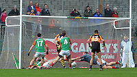 26-10-2014: Kieran Donaghy, Austin Stacks, breaks away from Ger Hartnett and goalkeeper Michael Moriarty,  Mid Kerry, to score  a goal  in the Kerry senior football County Championship final at Austin Stack Park, Tralee on Sunday.  Picture: Eamonn Keogh ( MacMonagle, Killarney)