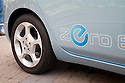 Close up of logo on Nissan Leaf electric car. Nissan Leaf Zero Emission Tour promotional event for the Nissan Leaf electric car that is scheduled to be released in Fall 2010. Car specs from Nissan: 5 person capacity, 90 MPH top speed, lithium-ion battery, 100 mile average range per charge. Santana Row, San Jose, California, USA, 12/5/09