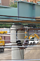Juxtaposition of Automobile Overpass Steel Beam, Catenary wiring and Insulators. Additional View taken during Construction Progress Photography of the Railroad Station at Fairfield Metro Center - Site visit 14 of once per month Chronological Documentation.