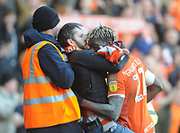 Blackpool's Armand Gnanduillet is mobbed by a fan as he celebrates scoring his side's first goal <br /> <br /> Photographer Kevin Barnes/CameraSport<br /> <br /> The EFL Sky Bet League One - Blackpool v Southend United - Saturday 9th March 2019 - Bloomfield Road - Blackpool<br /> <br /> World Copyright © 2019 CameraSport. All rights reserved. 43 Linden Ave. Countesthorpe. Leicester. England. LE8 5PG - Tel: +44 (0) 116 277 4147 - admin@camerasport.com - www.camerasport.com