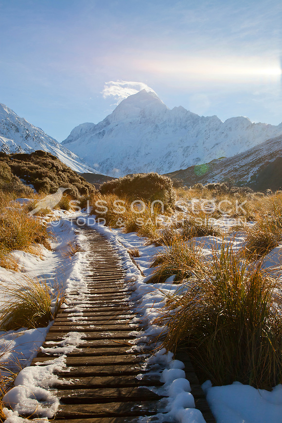 Snow covered boardwalk on the Hooker Valley track leading to Hooker Lake at Mt Cook / Aoraki, New Zealand.