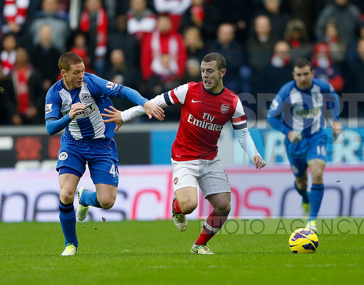 Wigan's James McArthur tussles with Arsenal's Jack Wilshere..Wigan v  Arsenal - Barclays Premier League - JJB Stadium, Wigan- 22/12/12 - Picture David Klein/Sportimage