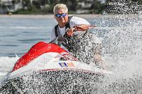 William Hanson, CEO of Bonita Jet Ski & Parasail at Doc's Beach House, shows off his waverunner skills on Gulf of Mexico at Bonita Beach, Florida, USA. Photo by Debi Pittman Wilkey