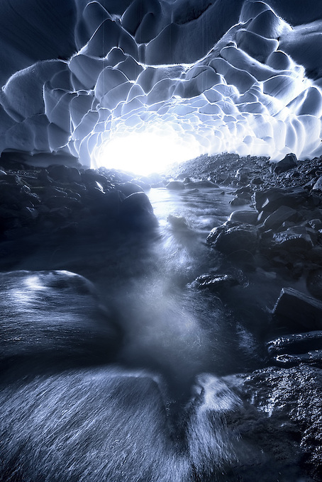 A frigid passageway formed by snow melt under a small glacier in the Mt. Rainier wilderness.