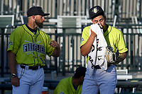 Starting pitcher Jose Butto (45) of the Columbia Fireflies wipes his face with a towel as he talks with pitching coach Royce Ring before a game against the Delmarva Shorebirds on Thursday, May 2, 2019, at Segra Park in Columbia, South Carolina. (Tom Priddy/Four Seam Images)