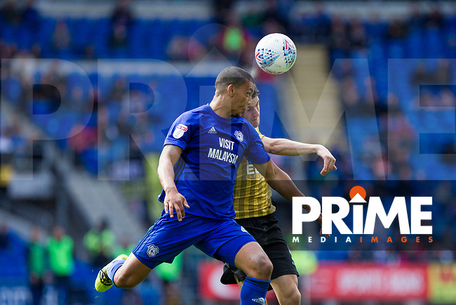 Lee Peltier of Cardiff City beats Kieran Lee of Sheffield Wednesday to a header during the Sky Bet Championship match between Cardiff City and Sheffield Wednesday at Cardiff City Stadium, Cardiff, Wales on 16 September 2017. Photo by Mark  Hawkins / PRiME Media Images.