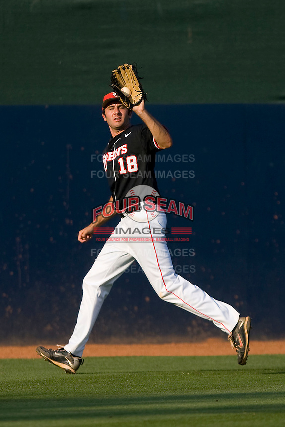 Left fielder Jeremy Baltz #18 of the St. John's Red Storm hauls in a fly ball against the Virginia Cavaliers in the championship game of the Charlottesville Regional at Davenport Field on June 5, 2010, in Charlottesville, Virginia.  The Cavaliers defeated the Red Storm 5-3.  Photo by Brian Westerholt / Four Seam Images