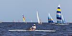 Boats sail and row off the beach at Shell Point Regatta during the 40th Annual Stephen C Smith Regatta April 27, 2013.<br />