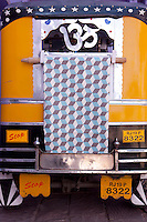 The back of a rickshaw is used to display a length of Osborne & Little fabric