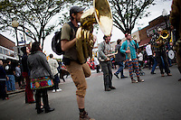 Bands and performers march from Davis Square in Somerville to Harvard Square in Cambridge, Massachusetts, USA, during the HONK! Festival. The HONK! Festival is an annual gathering of activist street marching bands that involves performances, a parade between Davis Square in Somerville and Harvard Square in Cambridge, and an academic symposium about street music.