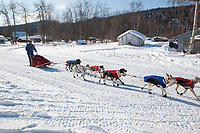 Rachel Scordis arrives at Grayling on a cold sunny afternoon during Iditarod 2009