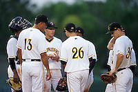 Bradenton Marauders Carlos Garcia #13 makes a pitching change with (L-R) catcher Carlos Paulino, third baseman Elevys Gonzalez, pitcher Eliecer Navarro #26, shortstop Gift Ngoepe (back), second baseman Benji Gonzalez (hidden), first baseman Alex Dickerson #30 during a Florida State League game against the Tampa Yankees at McKechnie Field on July 19, 2012 in Bradenton, Florida.  Bradenton defeated Tampa 4-3.  (Mike Janes/Four Seam Images)