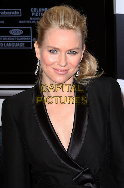 NAOMI WATTS.The Cinema Society and Angel By Thierry Mugler host a Screening of 'The International' held at AMC Lincoln Square, New York, NY, USA..February 9th, 2009.half length black tuxedo jacket dangling earrings.CAP/ADM/PZ.©Paul Zimmerman/AdMedia/Capital Pictures.