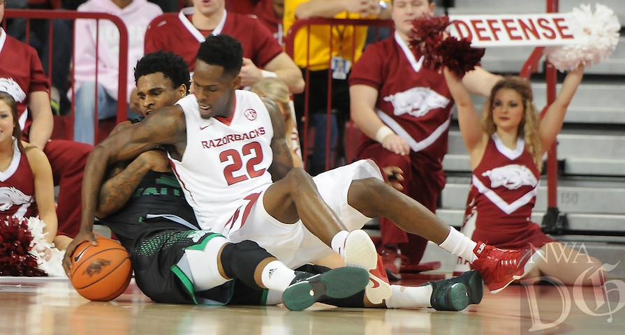 NWA Media/ J.T. Wampler -Arkansas' Jacorey Williams struggles for possession against Utah Valley's Marcel Davis Saturday Jan. 3, 2015 at Bud Walton Arena in Fayetteville. The Hogs won 79-46.