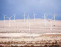 Spain, ESP, Canary Islands, Fuerteventura, Istmo de La Pared, 2012Oct13: Windmills stand in the desert of the Istmo de La Pared.