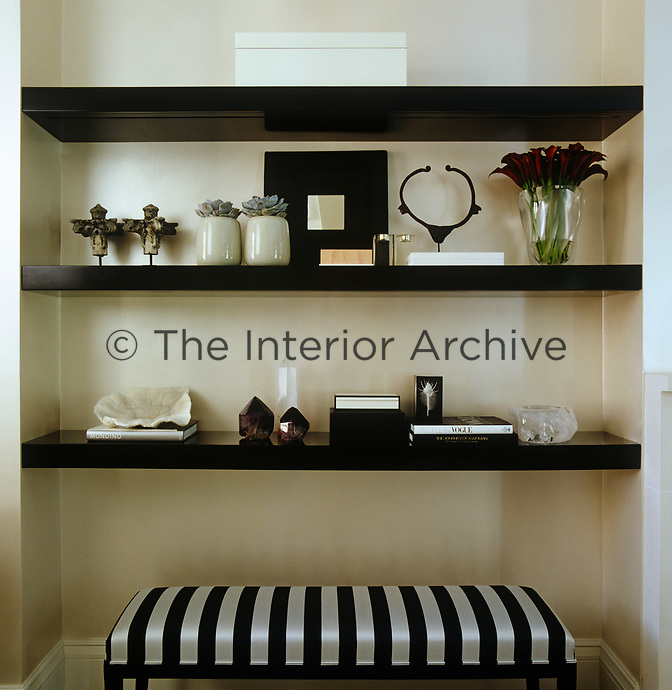 Open shelving in the living room displays a collection of prized objects
