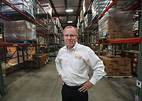 Feb. 20, 2019. San Diego, CA. USA| Feeding San Diego's CEO Vince Hall in the warehouse. | Photos by Jamie Scott Lytle. Copyright.