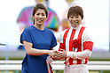(L-R) Saori Yoshida, Kenichi Ikezoe,<br /> APRIL 9, 2017 - Horse Racing :<br /> Jockey Kenichi Ikezoe poses with presenter Saori Yoshida during the victory ceremony after riding Reine Minoru to win the Oka Sho (Japanese 1000 Guineas) at Hanshin Racecourse in Hyogo, Japan. (Photo by Eiichi Yamane/AFLO)