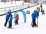 Children learning to ski at Blue Mountain, Collingwood, Ontario, Canada alpine ski resort.