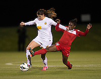 Brittany Taylor (13) of the Western NY Flash holds off Tiffany McCarty (14) of the Washington Spirit during the game at the Maryland SoccerPlex in Boyds, MD.  Washington tied Western NY, 1-1.