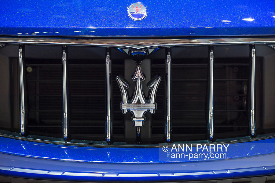 Manhattan, New York, USA. April 12, 2017.  Closeup of 2017 Maserati Levante S SUV with Blu Emozione Mica exterior, with trident emblem on grill and hood oval emblem, is on car on displayed at the New York International Auto Show, NYIAS, during the first Press Day at the Javits Center.