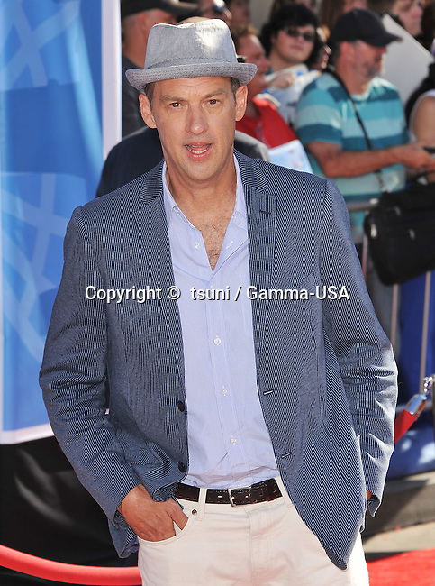 Anthony Edwards arriving at the Planes Premiere at the El Capitan Theatre in Los Angeles.