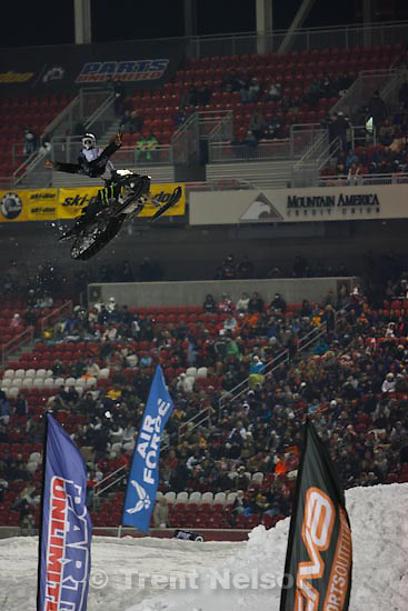 Trent Nelson  |  The Salt Lake Tribune.A rider on the Slednecks team warms up the crowd with some freestyle  tricks at the Western Nationals of the AMSOIL Championship Snocross Series at Rio Tinto Stadium in Sandy, Saturday, January 9, 2010.