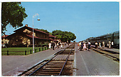 Santa Fe passenger train standing at Clovis depot.<br /> AT&amp;SF  Clovis, NM  ca. 1960