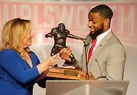 NWA Media/DAVID GOTTSCHALK - 12/8/14 - Justin Hardy of East Carolina University accepts the 2014 Burlsworth Trophy from Holly Rowe, sports commentator, Monday December 8, 2014 during a ceremony presented by the Springdale Rotary Club at the Springdale Convention Center. The other finalist for the aware were Ben Beckwith, from Mississippi State University, and Mark Weisman,  from the University of Iowa. Additional photographs available at:  nwaonline.com/photos