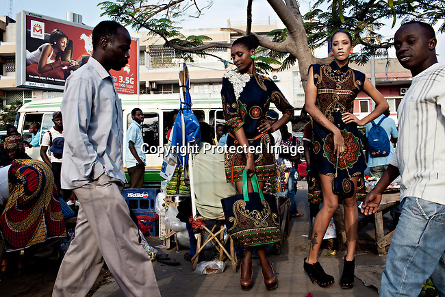 MAPUTO, MOCAMBIQUE - JUNE 27: Models for the fashion designer Taibo Bacar poses during a photo shoot on June 27, 2013 in central Maputo Mozambique. Taibo is one of the youngest and most celebrated African designers and he has shown his designs around Africa and the world. (Photo by: Per-Anders Pettersson)