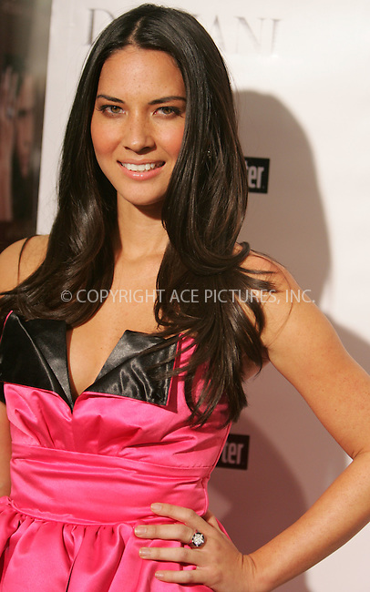 WWW.ACEPIXS.COM . . . . . ....December 3 2009, Hollywood....Actress Olivia Munn at the Damiani Diamonds & The Hollywood Reporter Power 100 Women in Entertainment on December 3, 2009 in Beverly Hills, California.....Please byline: JOE WEST- ACEPIXS.COM.. . . . . . ..Ace Pictures, Inc:  ..(646) 769 0430..e-mail: info@acepixs.com..web: http://www.acepixs.com